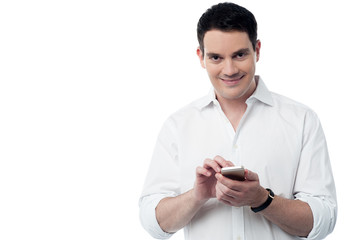 Smiling smart using his cell phone