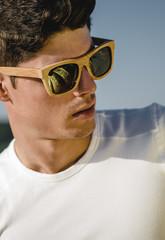Model man portrait with wooden sunglasses
