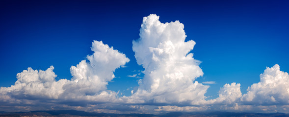 Double cumulonimbus cloud in a deep blue sky