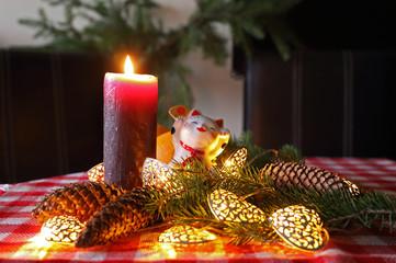 New Year decoration with maneki neko, candle and christmas tree.