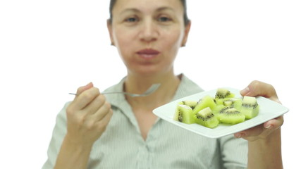 Woman Eating Kiwi Fruit Off of Plate
