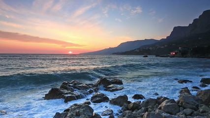 Sea waves hit coastal stones