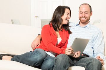 Couple is using a tablet pc together