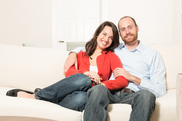 Couple having fun in living room