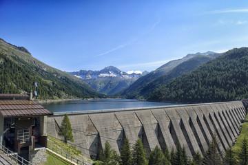 Landscape mountains Lake Dam in Italy Trentino Dolomites Alps