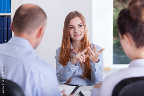 Woman during her job conversation - 72226915