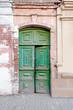 Old wooden door painted in green color in Russia