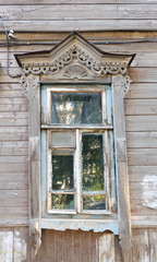 Old window in Astrakhan. Ancient Russian architecture sample.