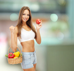 Shopping concept. Beautiful young woman with vegetables in