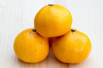 Oranges on wooden base