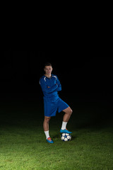 Portrait Of A Soccer Player On Black Background