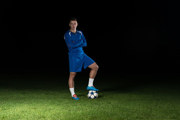 Portrait Of A Soccer Player And Ball