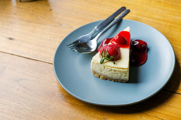 Strawberry Cheesecake on wooden table
