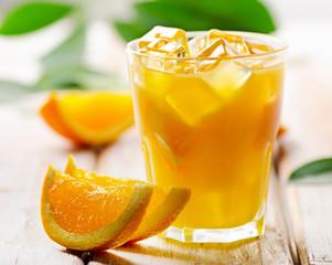 Orange juice  with  fresh fruits on  wooden background