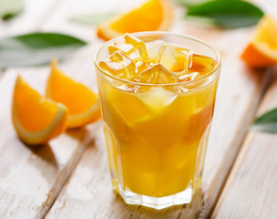 Orange juice in glass with  fresh fruits on  wooden background