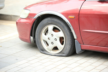flat tyre on car wheel