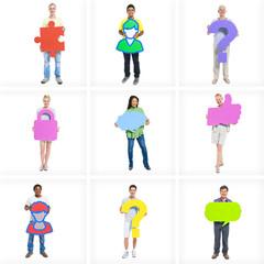 Multiethnic Group of People Holding Symbols
