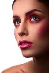 Fashion beauty female model with pink and orange makeup