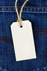 price tag from recycled paper on twine cord on jean background
