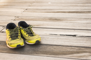 Running shoes on a wooden background