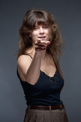 Young Woman with Brown Hair Pointing