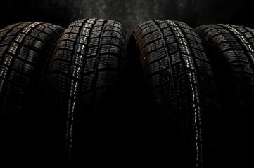 Dark background with winter tires