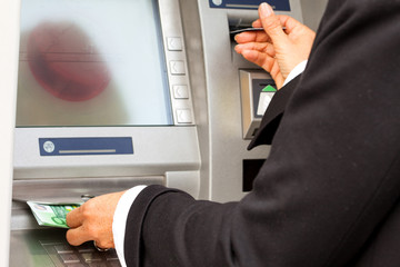 Taking cash from automated cash machine