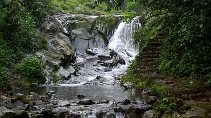 View of waterfall in Indonesian jungle