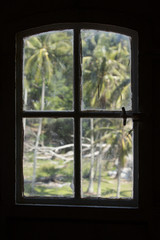 Indonesian lighthouse window silhouette, palm trees
