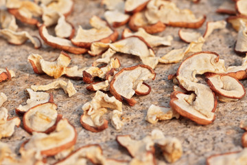Sun drying sliced apples with selected focus