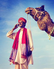 Indian Man On the Phone Camel Communication