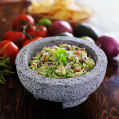 granite molcajete and mexican guacamole with vegetables