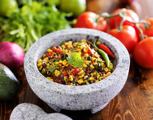 mexican stone molcajete with fire roasted corn salsa