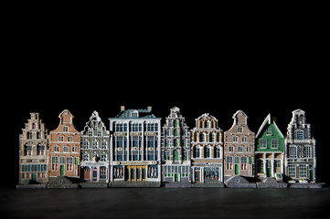 Spooky canal houses agains black background