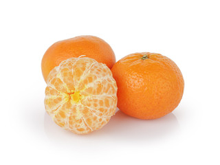 three ripe tangerines