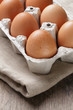 brown raw chicken eggs in container