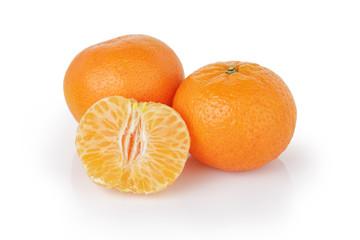 three ripe tangerines