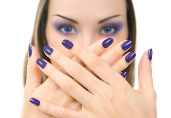 Beautiful women eyes with stylish make-up and hands with purple