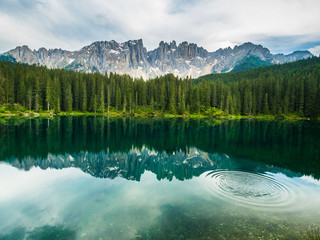 Latamar mountain and woods reflected in lake Carezza, Dolomites