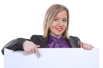 Businesswoman pointing and showing blank banner