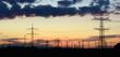 canvas print picture - Windräder und Strommasten im Abendlicht