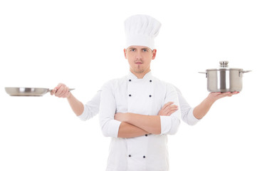 cooking concept - young man in chef uniform with four hands hold