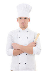 young man chef  holding kitchen equipment isolated on white