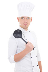 young man in chef uniform with sauce spoon isolated on white