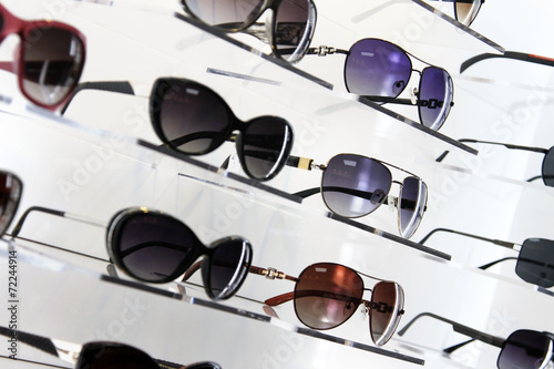 shop shelves with sunglasses - 72244914