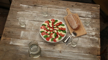 Preparation and eating caprese salad - timelapse HD