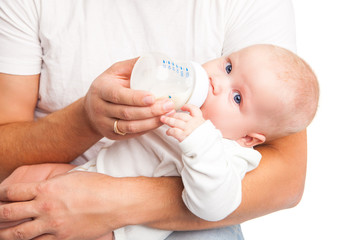 Young father holding and feeding her baby