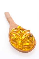 Fish oil in wooden spoon