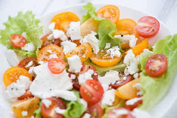 Vegetable salad with feta cheese, close-up, studio shot