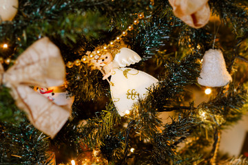 angel, christmas decorations and fir branch